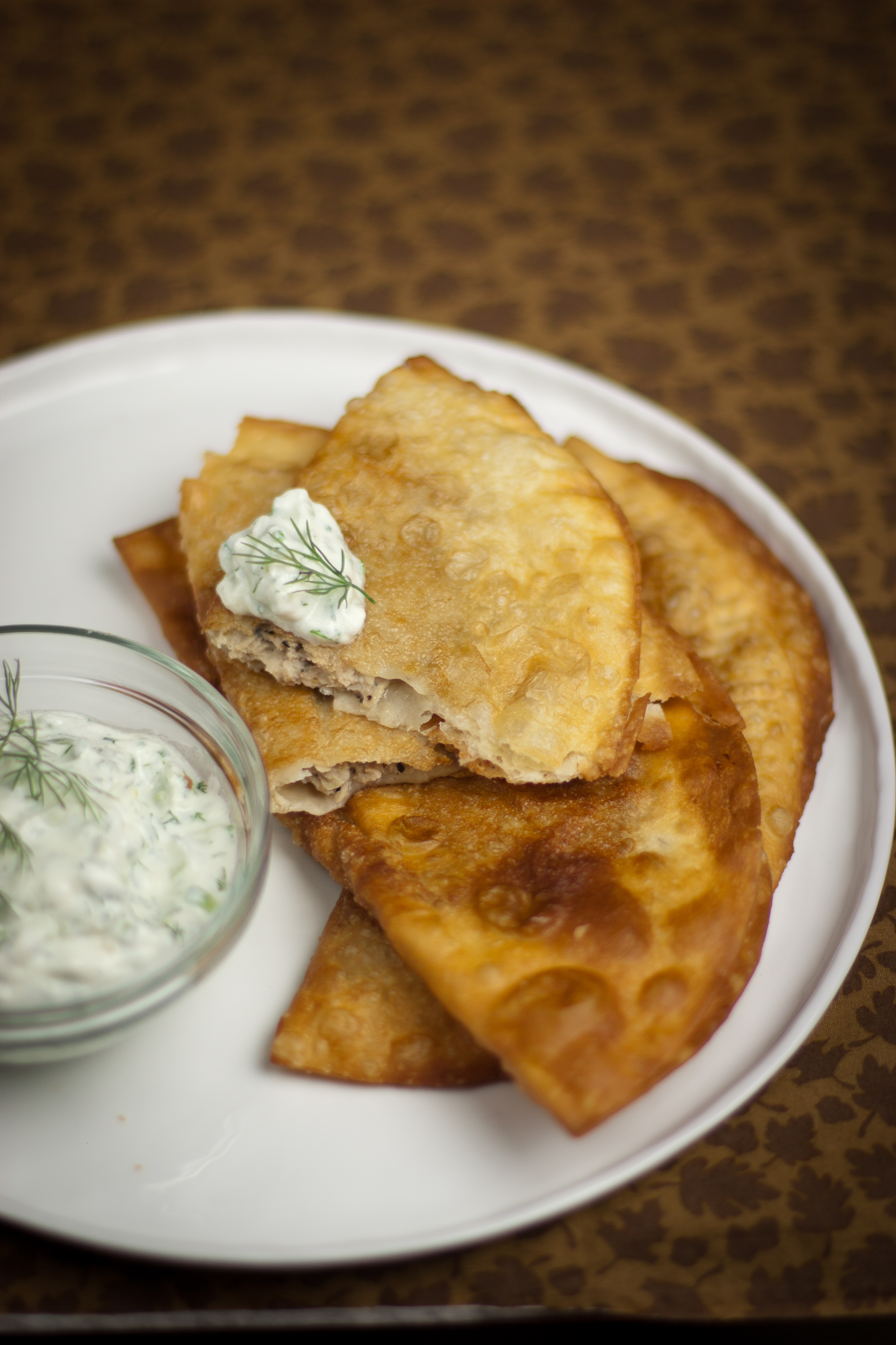 Quick Chebureki - Use regular flour tortillas to make these crispy pockets filled with succulent meat filling for dinner or a snack. No one will be able to refuse these!
