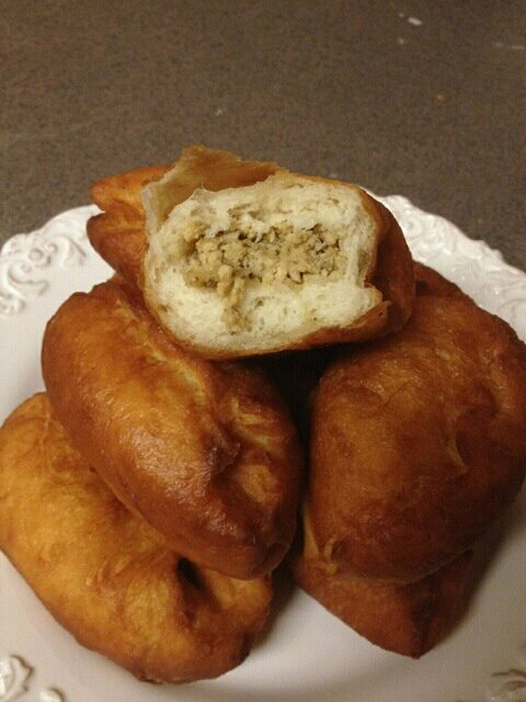 Meat Piroshki are little pockets of soft yeast dough, stuffed with juicy filling and then fried for glorious perfection of a bite.