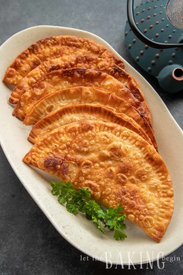 Chebureki recipe perfectly made and fried to a golden brown color
