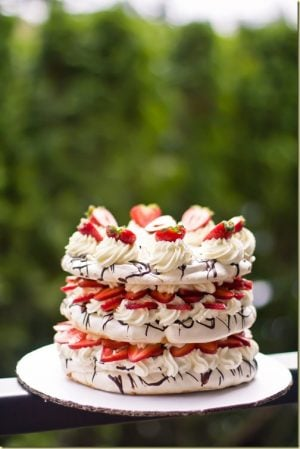 Boccone Dolce is a naturally gluten free, light and airy dessert with just the right amount of zing from the berries. It is made with delicate, melt in your mouth meringue which is is sandwiched with sweetened whipped cream & berries. The chocolate drizzle on each layer, definitely takes this cake over the top!
