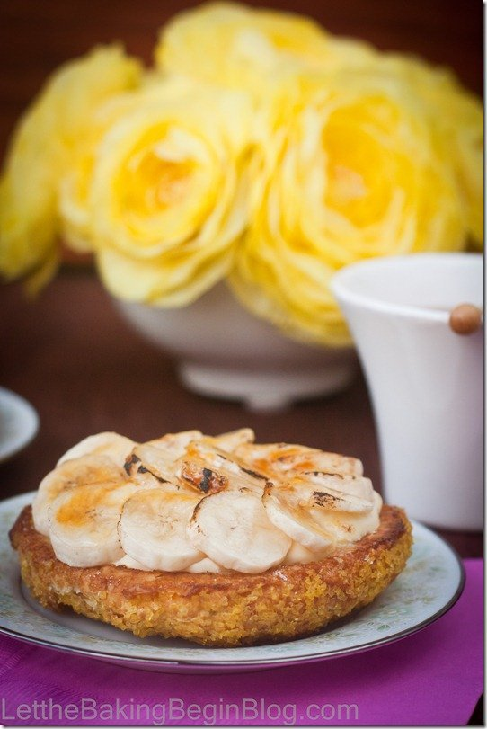 Banana Creme Brulee tart on a plate topped with toasted bananas.
