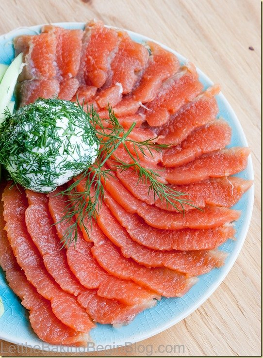 Lox fanned on a blue plate with dill on top