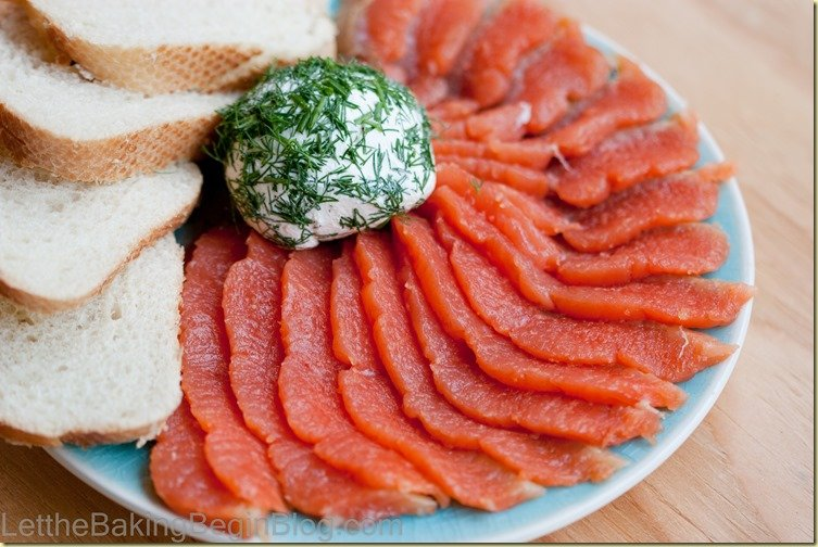 Lox bagel on a platter - fanned salmon slices and sliced bagels