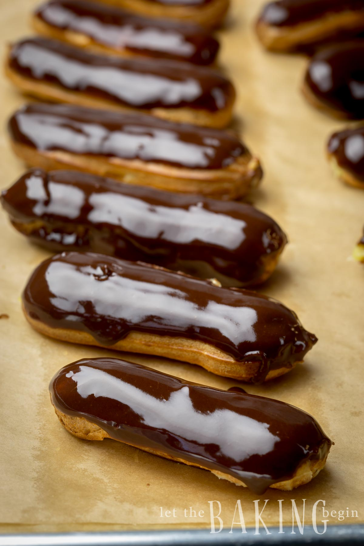 Classic Eclair is a Pate a Choux based hollow pastry shell filled with creamy custard, then dipped into a chocolate glaze. Simple, yet sophisticated and all around delicious! Learn the tips and tricks to making the perfect hollow shells and the creamiest custard filling