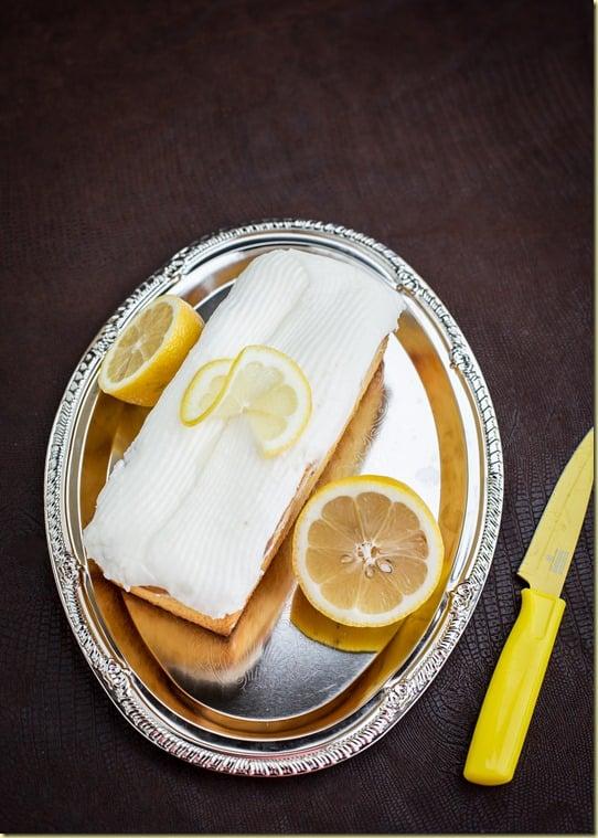 The True Copycat lemon loaf recipe, fluffy, yet dense, yet moist with a delicious lemony glaze.