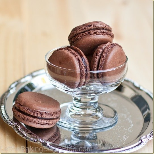 Dark Chocolate Truffle Macarons - Fragile, yet soft; fudgy and full of intoxicating chocolate Dark Chocolate Truffle Macarons are amazing! by LetTheBakingBeginBlog.com