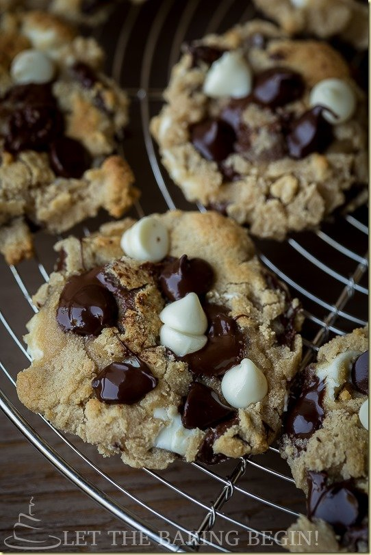 Close up picture of a chocolate chip cookie on a cooling rack.Close up picture of a chocolate chip cookie on a cooling rack.