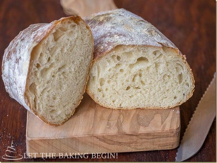 Crispy Rustic Farmer's Bread on cutting board with a bread knife.