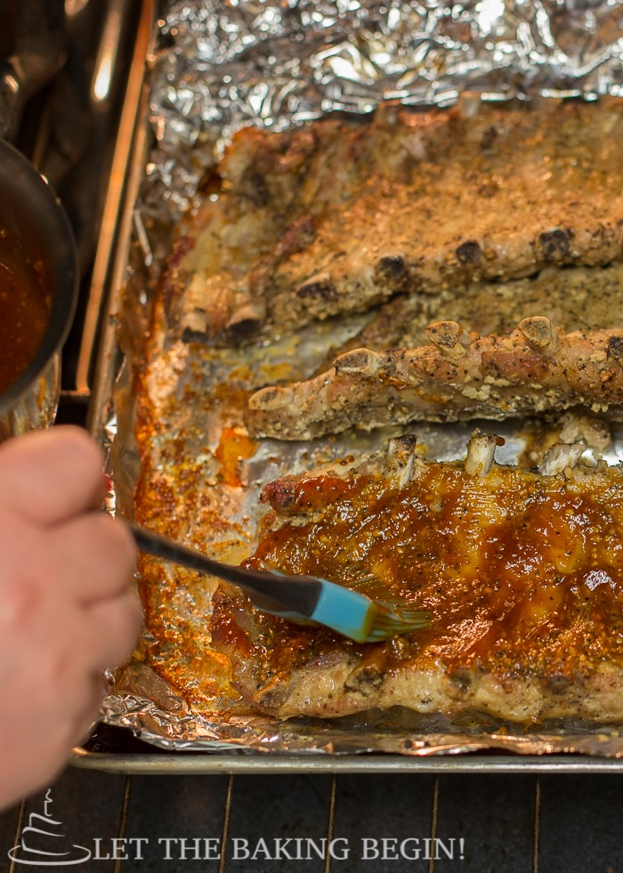 Fall Off the Bone Pork Ribs w/ Homemade Sweet and Tangy BBQ Sauce -You will want to eat the whole thing yourself!