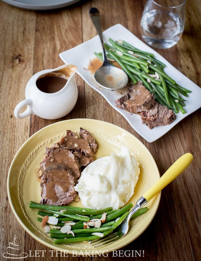 Perfectly Simple Pot Roast is just that, perfect and simple! The beef is placed into a slow cooker along with some vegetables, then, hours later you have a beautiful fall apart, soft hunk of meat to serve with gravy with mashed potatoes, rice or even noodles!