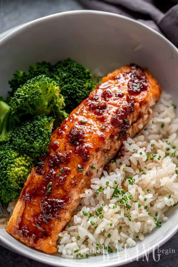 Bed of rice with fish and salmon glaze on top. Broccoli is served as one of the sides.