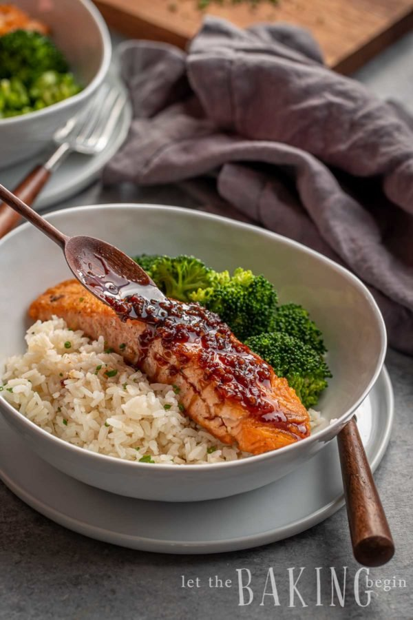 Honey Glazed Salmon on a bed of rice. Broccoli is on the side of the salmon.