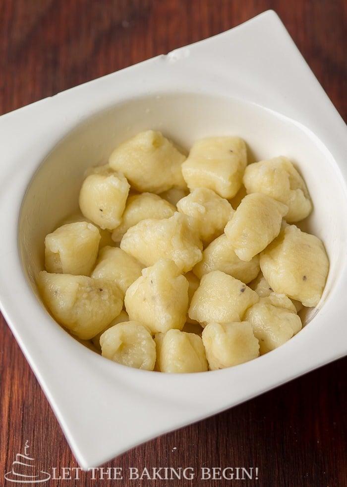 White bowl of fluffy lazy pierogi.