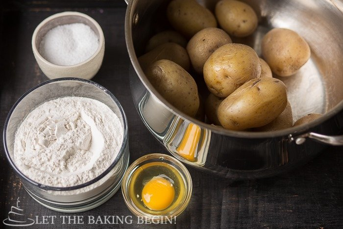 Ingredients needed to learn how to make gnocchi - potatoes, flour, and egg.
