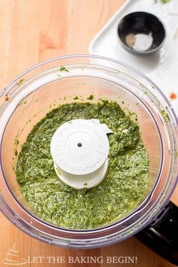 Blended chimichurri sauce on a blender.