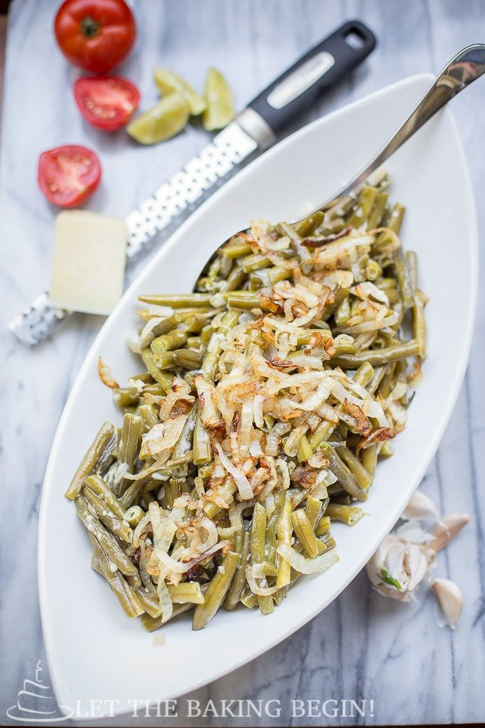 Creamy Garlic Parmesan Green Beans, simmered in the white garlic sauce until the flavor has permeated all the way through.