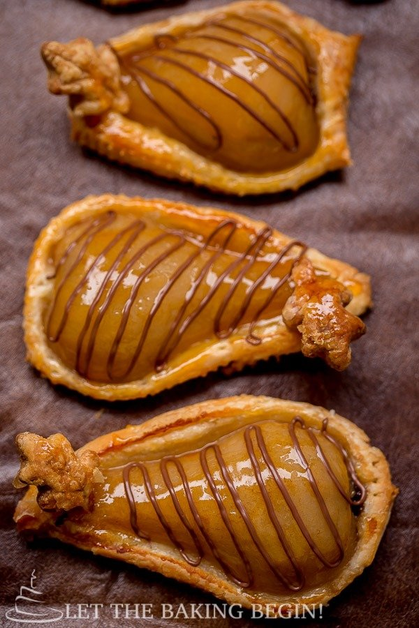 Pastries filled with poached pears and topped with Nutella.