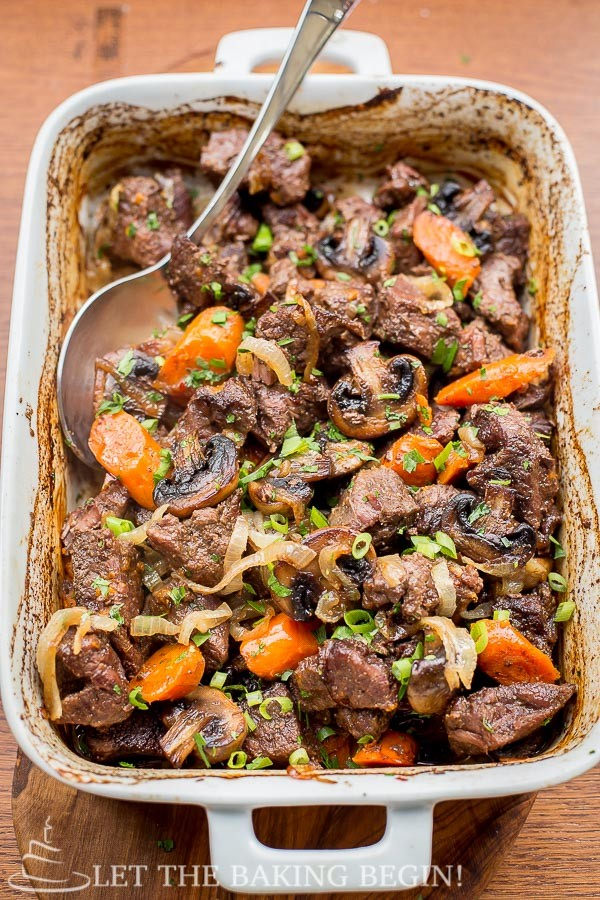 Beef with Caramelized Onions and Mushrooms with carrots and chopped greens.