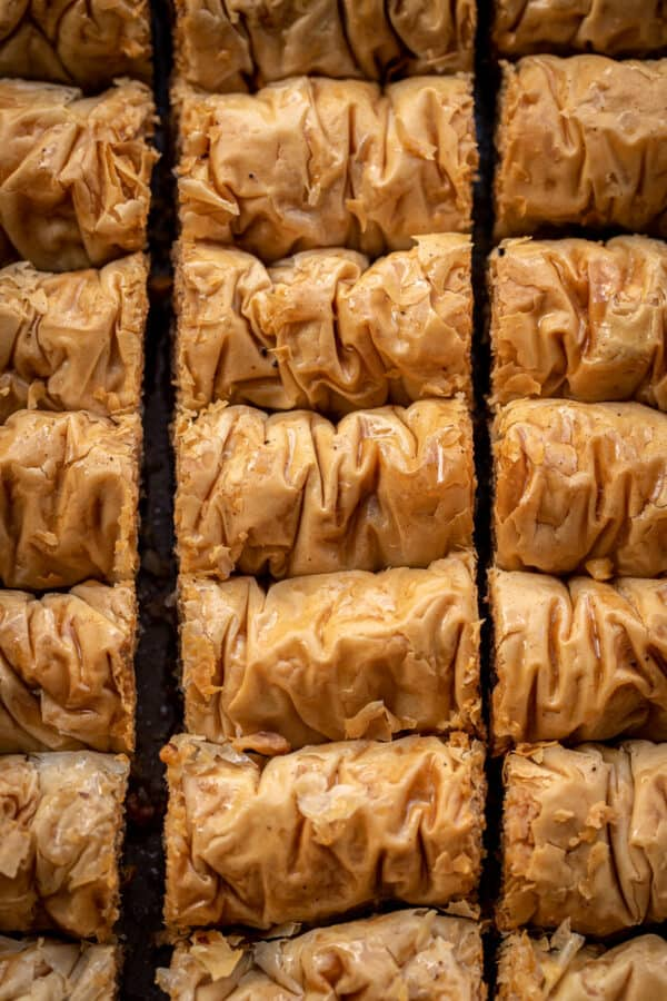 Rows of baklava rolls, overhead view.