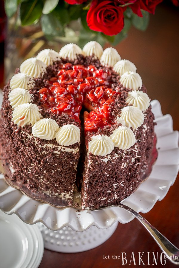 Fully assembled Black Forest Cake on a white serving plate.