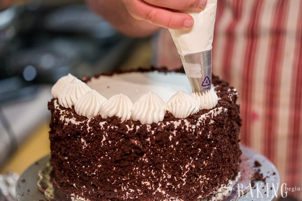 Black Forest Cake - classic combination of moist chocolate buttermilk cake layers, sweetened whipping cream and sour cherry filling. Follow this clear, step by step photo tutorial for a foolproof result.