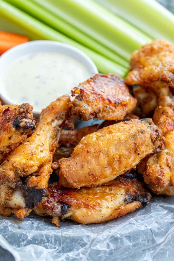 Garlic Ranch Wings on a plate with ranch, and vegetables.