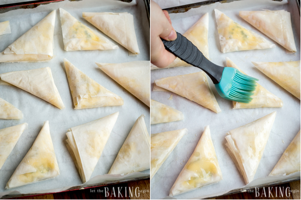 Spinach and Feta Phyllo Triangles - Spanakopita | Phyllo dough pockets filled with spinach and feta.