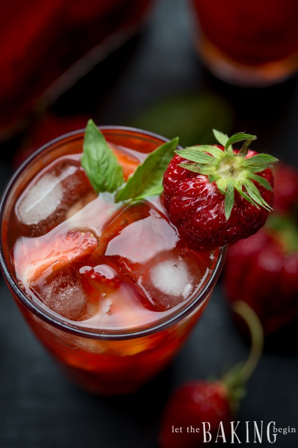 Top view of strawberry ice tea with mint and strawberries.