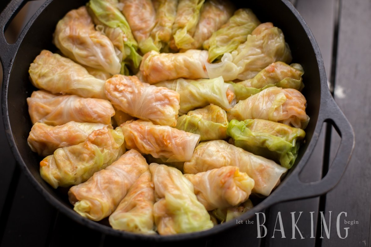 Stacking the stuffed cabbage rolls in a Dutch oven.