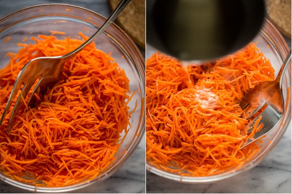 Spicy Korean Carrots mixed in the ingredients and hot oil.