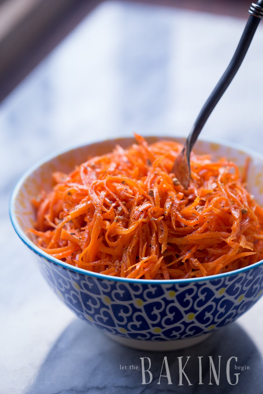 Spicy Korean Carrot Salad is a must-have recipe for grilling season. A mix of garlic, coriander, hot oil and other spices transform the carrots into something unbelievable! | Let the Baking Begin!