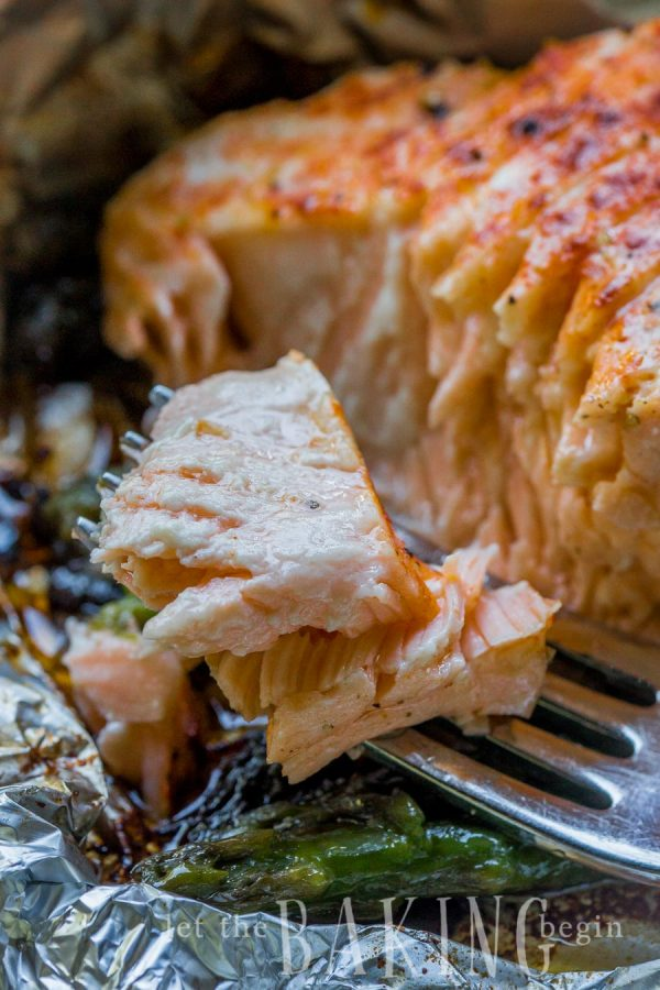 A fork with baked salmon in foil
