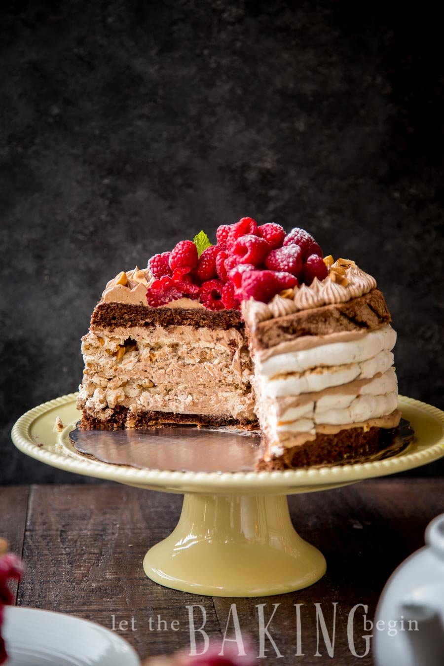 Hazelnut Meringue Nutella Cake - Layers Chocolate Poppyseed Cake, Hazelnut Meringue and Nutella Custard Buttercream will have your guests swoon from this deliciousness! Step by Step pictures are included for guaranteed success! | by Let the Baking Begin!