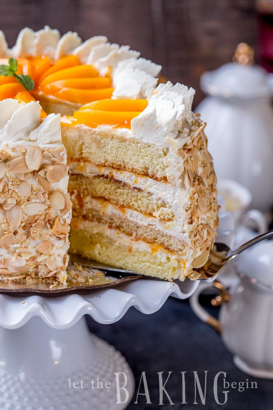 Peaches and Cream Cake Recipe - Easy Dessert made of Soft layers of Sponge Cake with Chunky Peach Preserve and lightly sweetened Whipped Cream. Roasted Almonds add a nice pleasant crunch for a textural contrast. | By Let the Baking Begin!