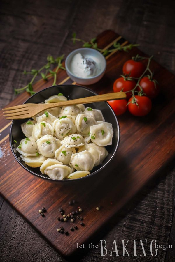 Bowl of chicken pelmeni - tiny dumplings made with soft and easy to make dough, then filled with juicy ground chicken.