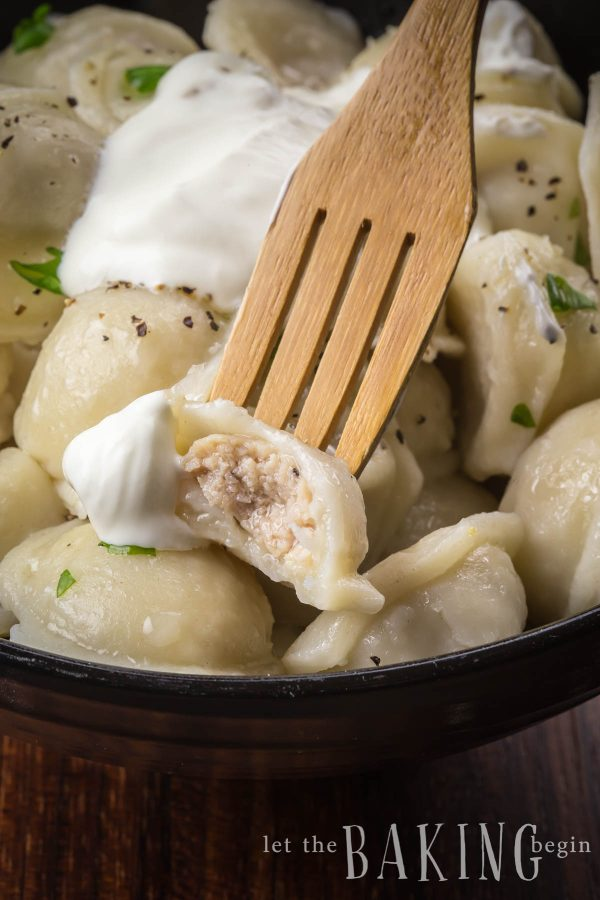 Chicken Pelmeni - tiny Russian dumplings filled with a juicy ground chicken mixture and served dipped in sour cream.