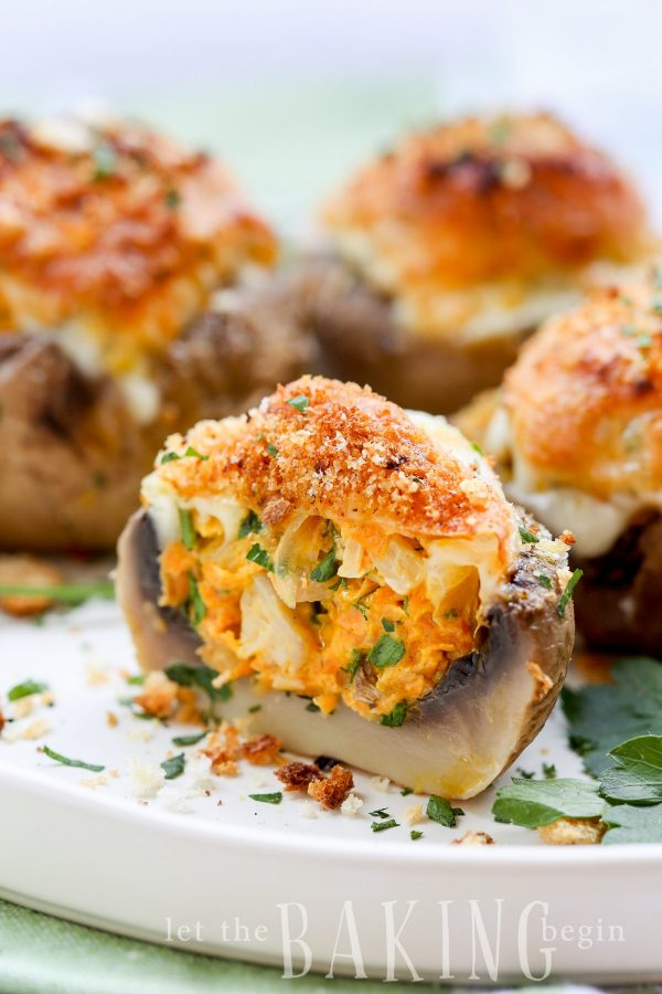 Cheesy Stuffed Mushroom Recipe (Vegetarian) - These are such a hit at parties! The filling of caramelized onions, mushrooms, carrots, garlic and CHEESE come together into the perfect bite!