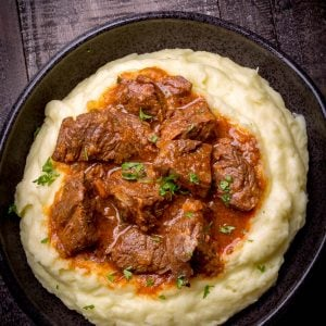 Beef Stew made in an Instant Pot with Beef, Onions, Carrots, Tomato Sauce and Spices. No fancy ingredients, but super delicious! Serve with Mashed Potatoes, Rice or Pasta and you'll have the ultimate comfort food dinner experience!