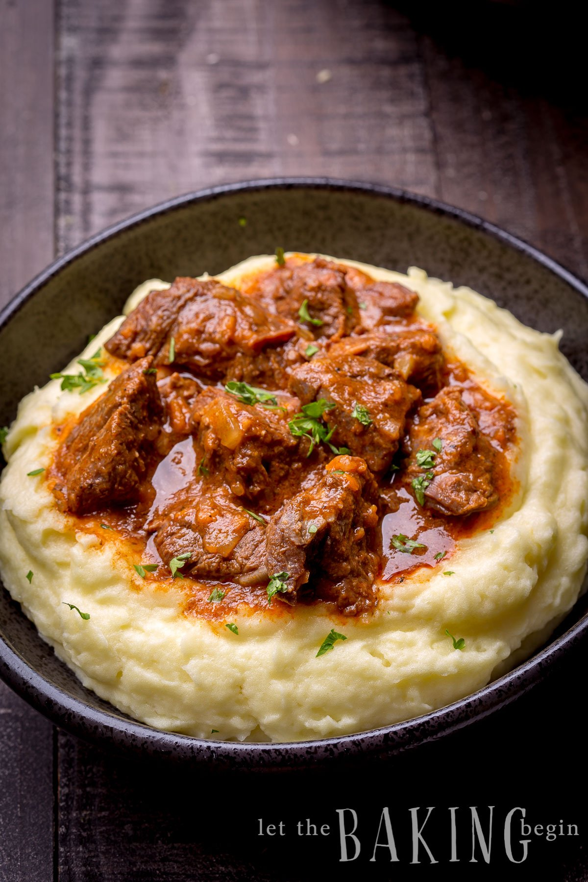 One Pot Easy Beef Stew made in an Instant Pot with Beef, Onions, Carrots, Tomato Sauce and Spices. No fancy ingredients, but super delicious! Serve with Mashed Potatoes, Rice or Pasta and you'll have the ultimate comfort food dinner experience!