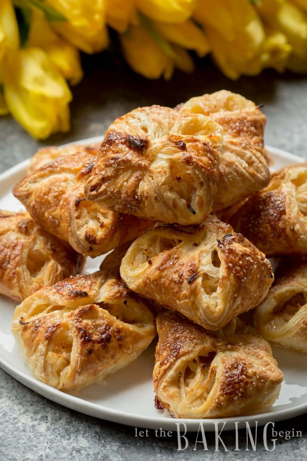 Plate piled with apple turnovers.