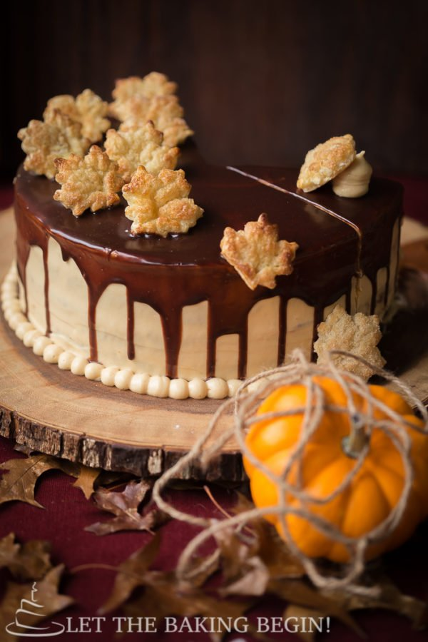 This Moist and Delicious Layered Pumpkin Cake is made with Fluffy Cream Cheese Frosting and a drizzle of Chocolate. The Cream Cheese Frosting has some dulce de leche added, so you know it's extra good! Make this showstopper for Thanksgiving and you'll be the talk of the town, for sure!