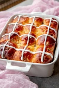 Hot Cross Buns are made with delicious buttery brioche dough, rum soaked fruits and white chocolate.