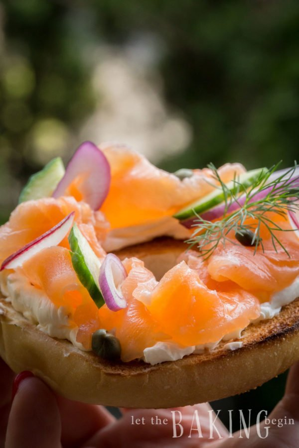 Smoked Salmon on a bagel with cream cheeses, onions, cucumbers and radishes.