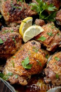 Baked Lemon Chicken with lemon slices and parsley over the top.