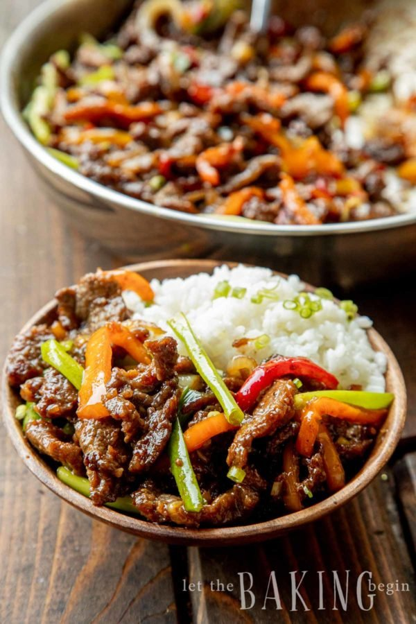 Easy Mongolian beef recipe served on top of a bowl of white rice.