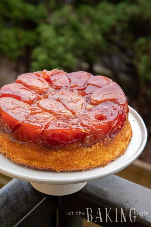 Apple upside down cake on a white cake platter