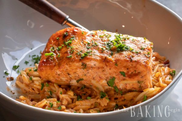 Oven roasted salmon over a bowl of orzo.