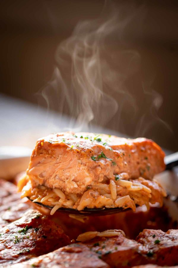 A spoonful of Roasted Salmon Pasta Casserole with steam rising.