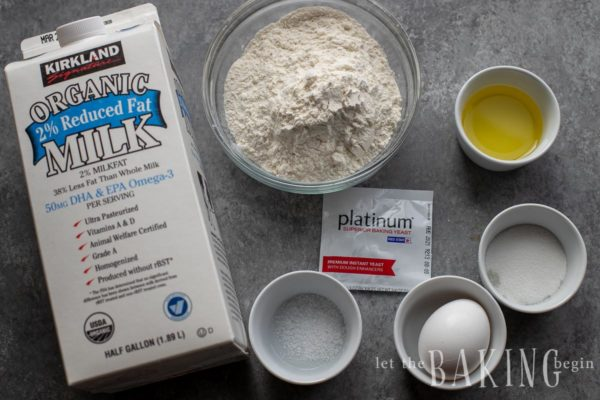 Blini ingredients layed out on a counter such as milk, sugar, flour, oil, and yeast