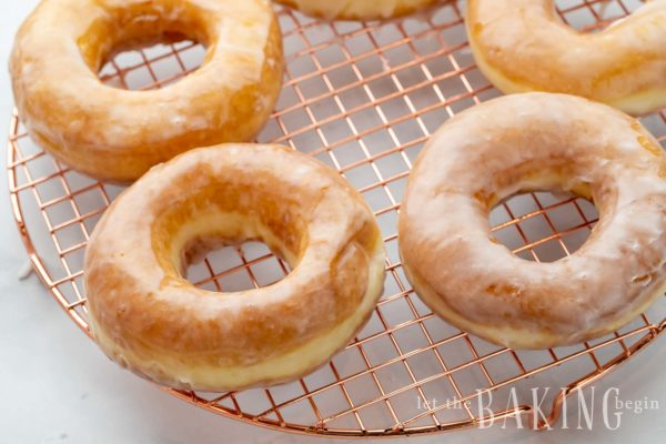 Copycat Krispy Kreme donut recipe glazed on a drying rack